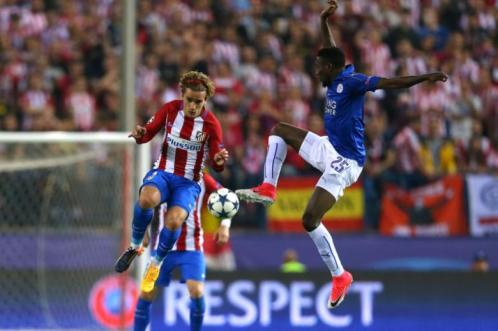 Atletico Madrid's Antoine Griezmann in action with Leicester City's Wilfred Ndidi